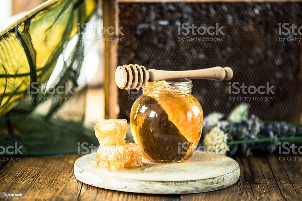 Honey and beekeeper hat with net royalty-free stock photo
