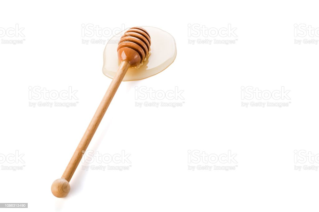 Honey and honey dipper on white background stock photo