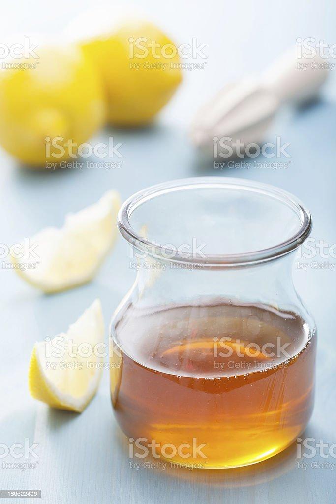honey and lemon over blue background royalty-free stock photo