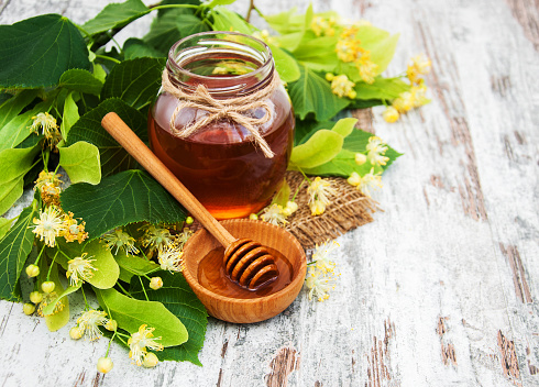 istock Honey and  linden flowers 885289896