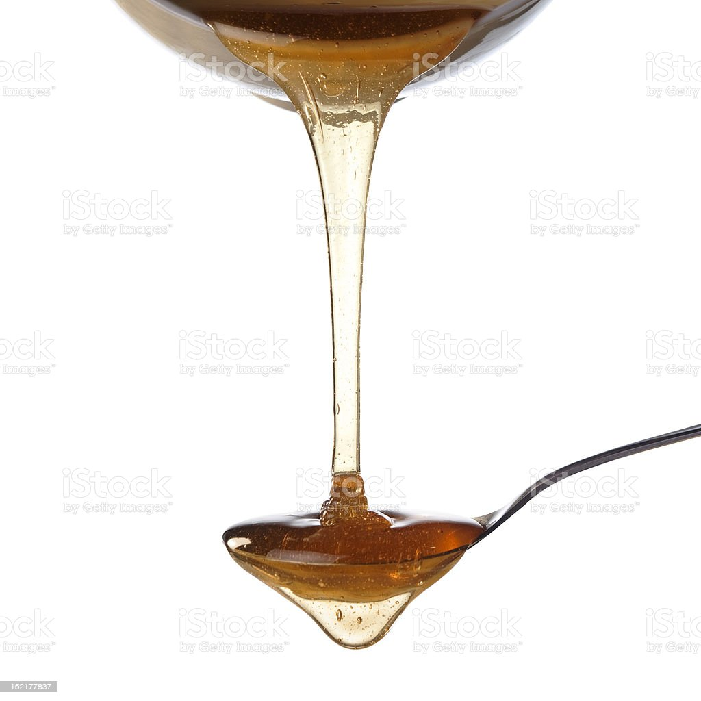 Honey and spoon royalty-free stock photo