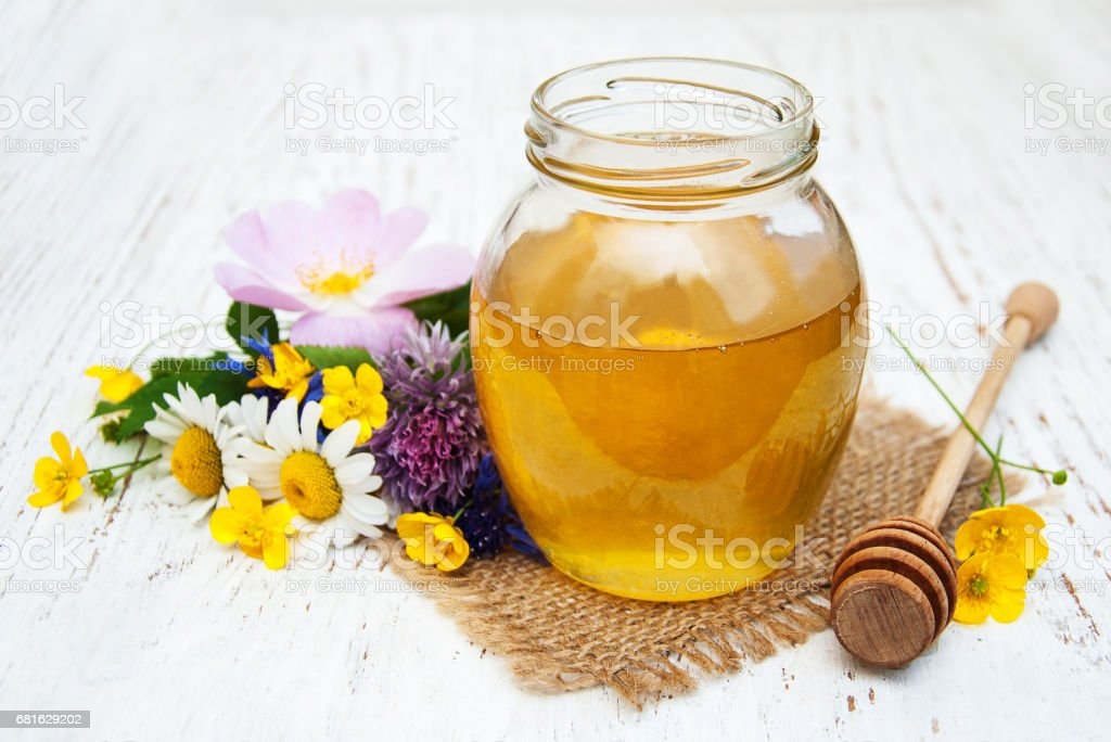 Honey and wild flowers stock photo