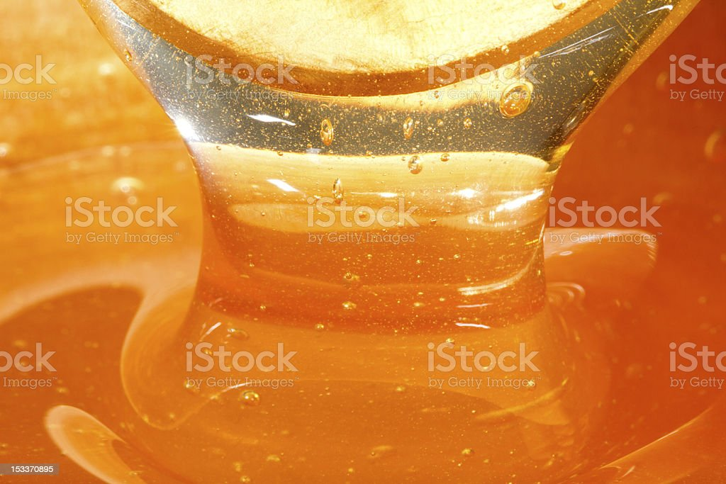 honey and wooden spoon royalty-free stock photo
