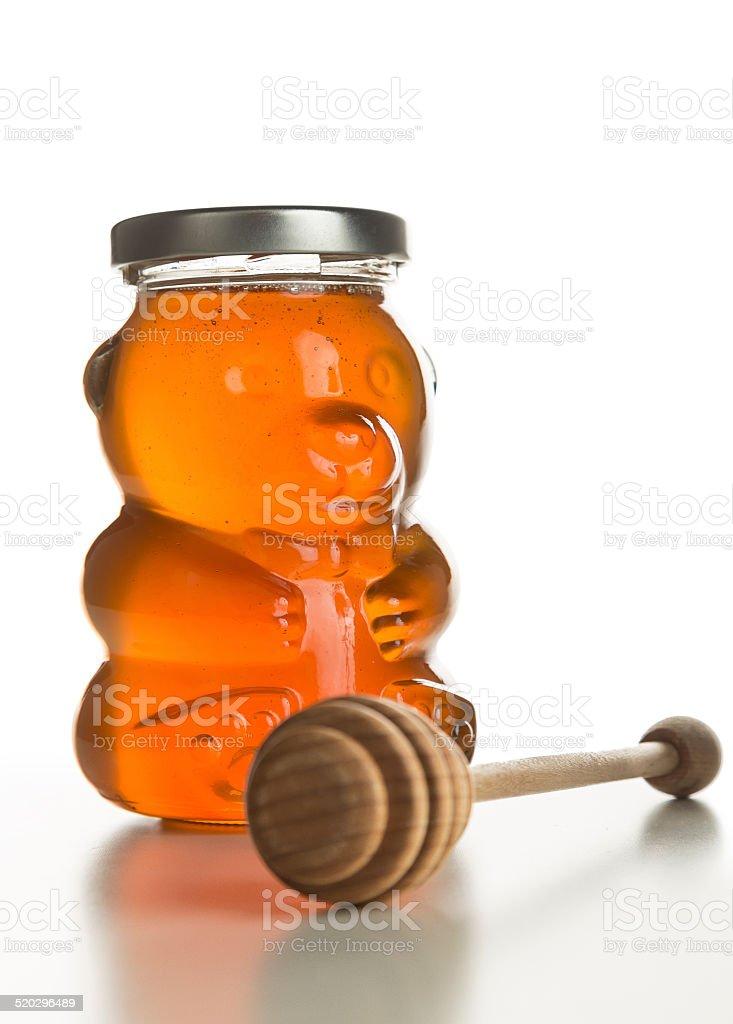 Honey Bear (jar) with Honey Dipper Aside, Isolated on White. foto