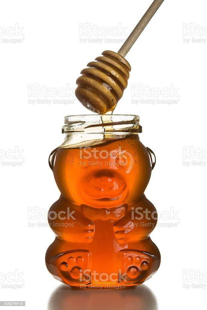 Honey Bear (jar) with Honey Dipper Isolated on White. foto