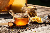 istock Honey bee and Honeycomb with honey dipper on wooden table. Beekeeping concept 1272903568