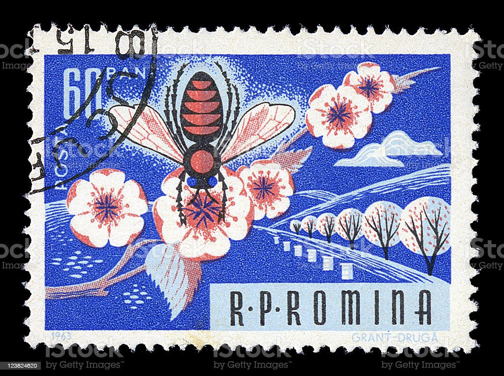 honey bee on flower vintage postage stamp stock photo