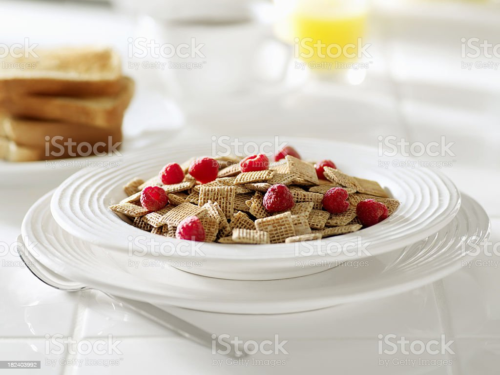 Honey Breakfast Cereal with Raspberries stock photo