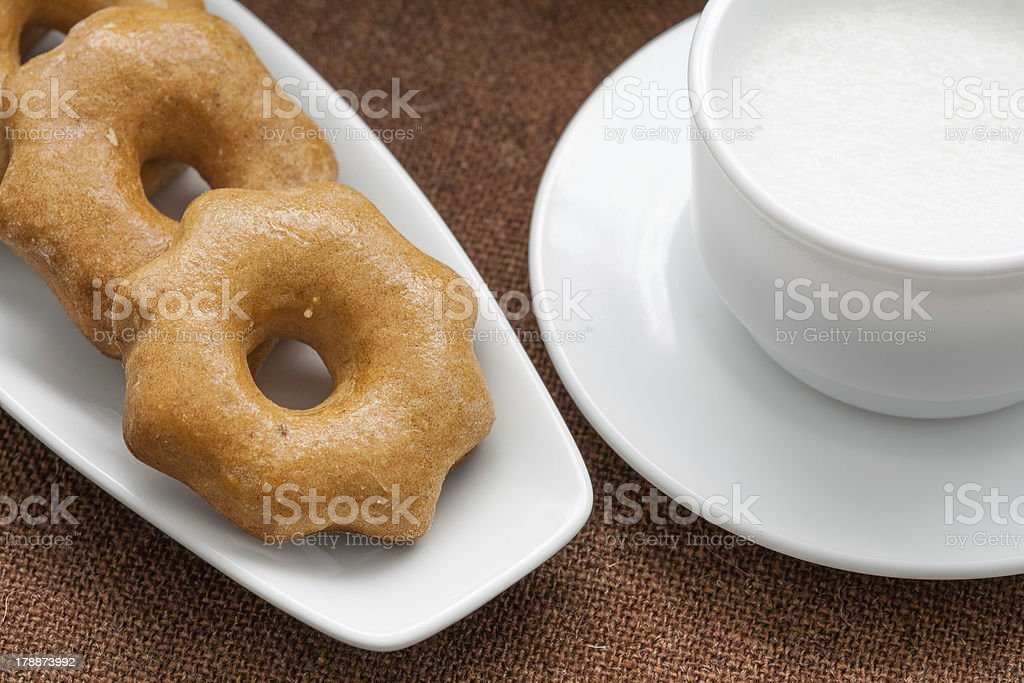 honey cookies on a plate and cup of milk royalty-free stock photo