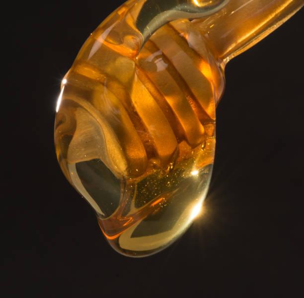 honey dripping stock photo