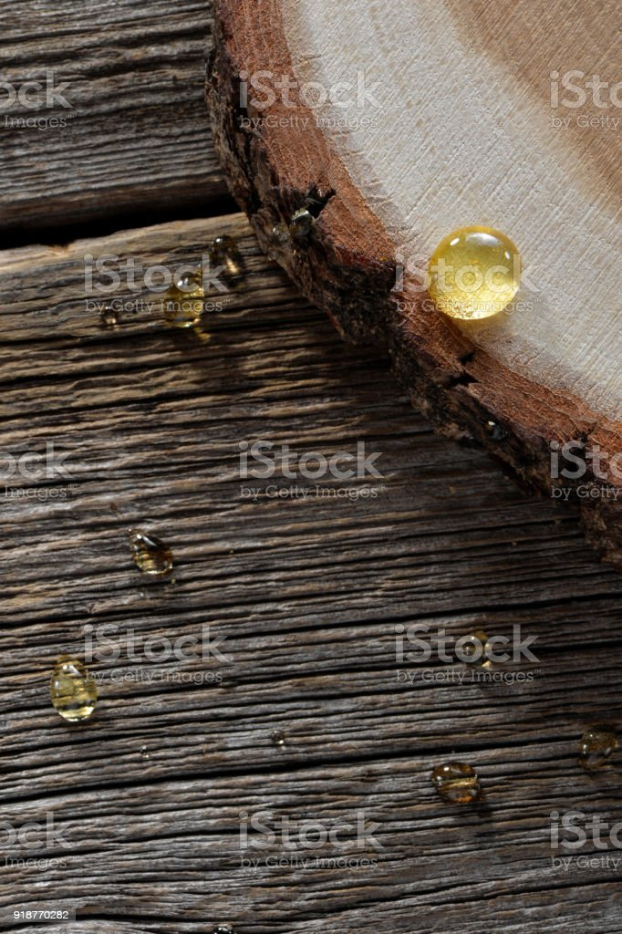honey drops close-up on wooden boards background stock photo