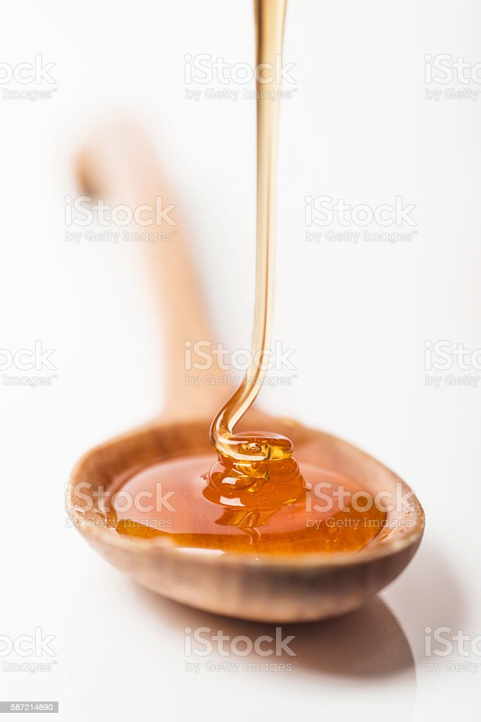 Honey Falling to Spoon stock photo