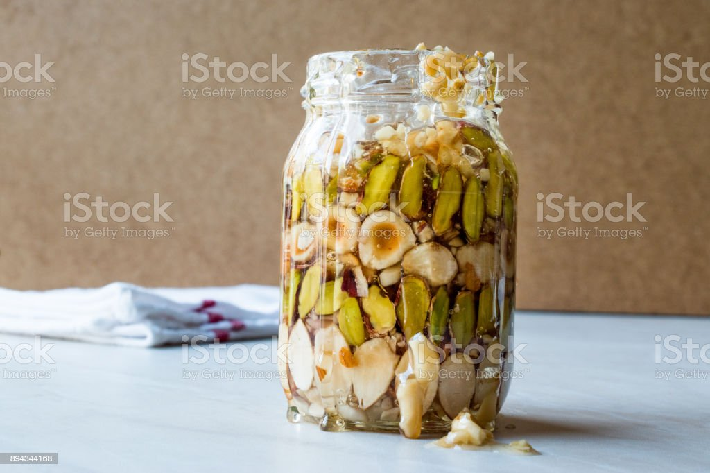 Honey Flavored Nuts, Almonds and Peanut Brittle Dessert in Jar stock photo