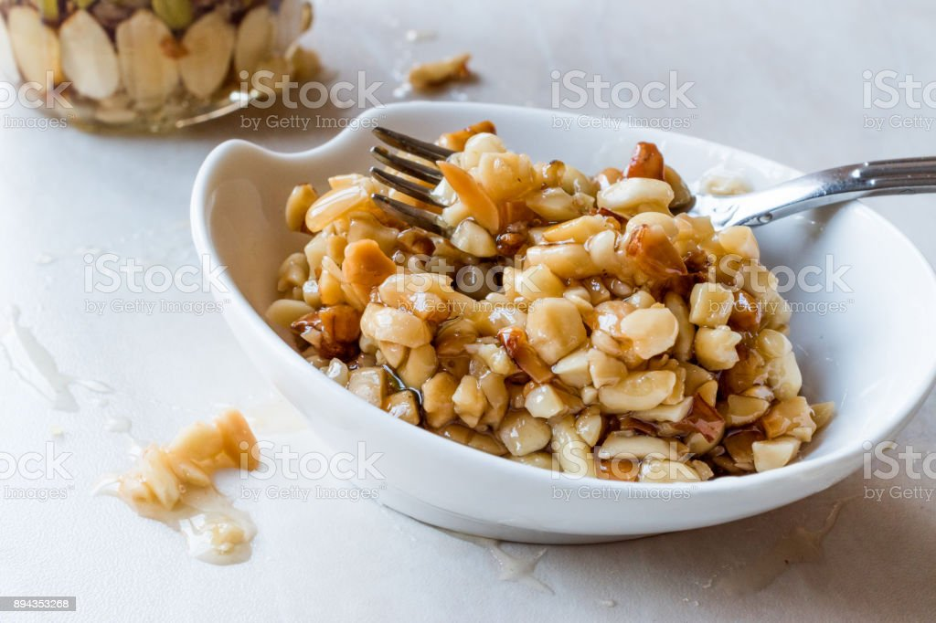 Honey Flavored Nuts, Almonds and Peanut Brittle Dessert. stock photo