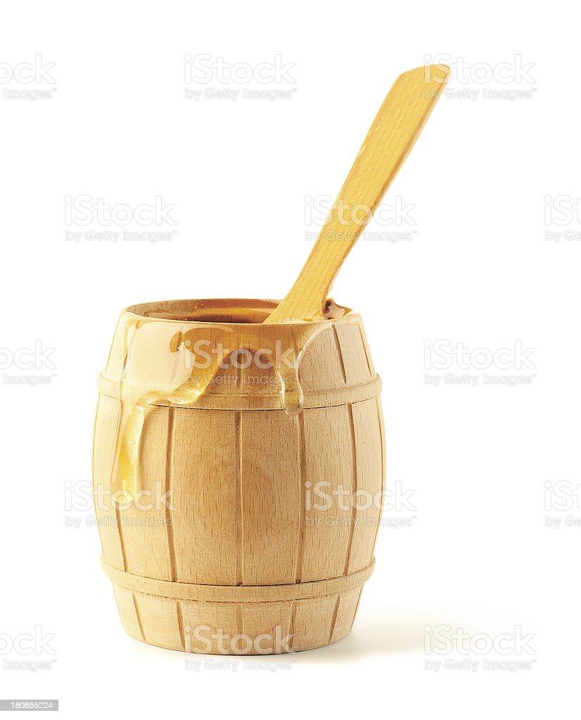 Honey flows on a keg royalty-free stock photo