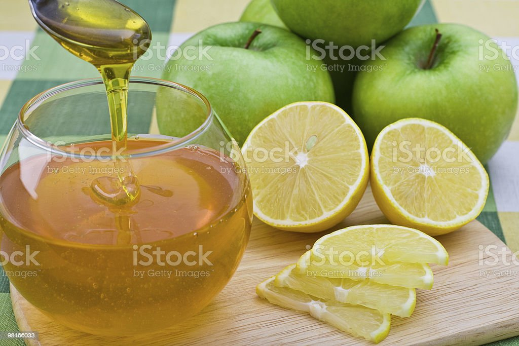 Honey, green apples and lemon. royalty-free stock photo