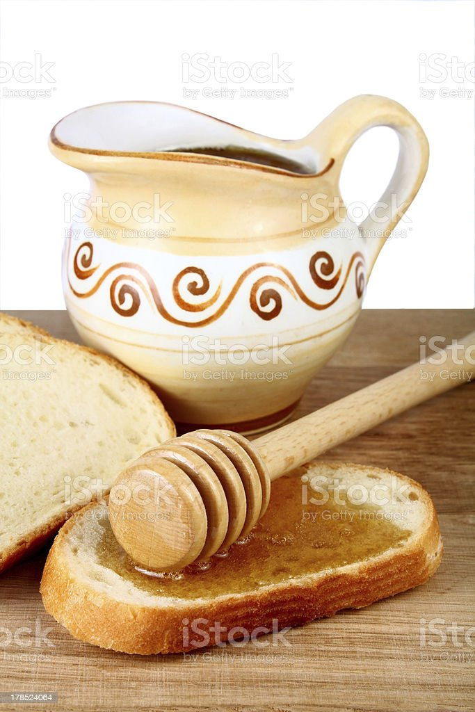 honey in a jug and loaf on board royalty-free stock photo