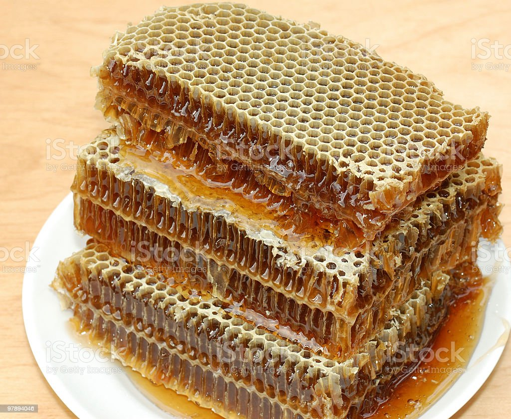 Honey in cells royalty-free stock photo