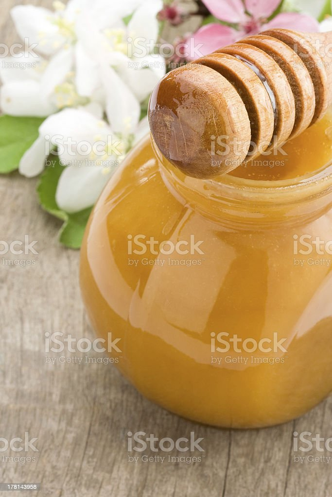 honey in glass jar and stick royalty-free stock photo