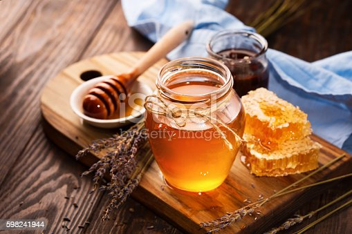 Honey In Jar And Bunch Of Dry Lavender Stock Photo & More Pictures of Blue