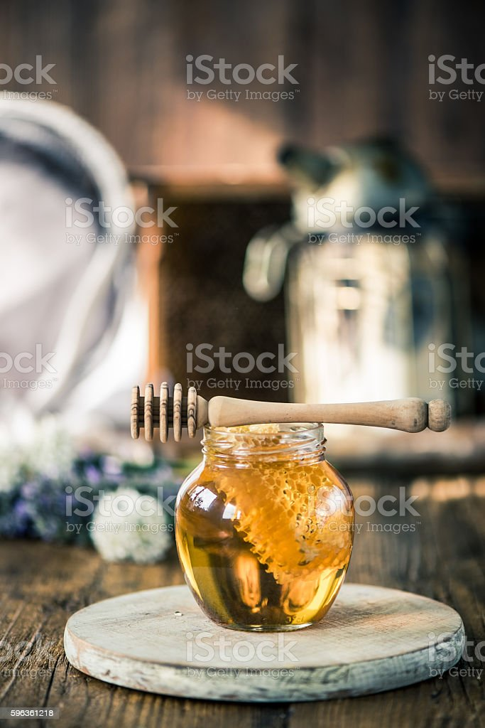 Honey jar and beekeeper tools royalty-free stock photo