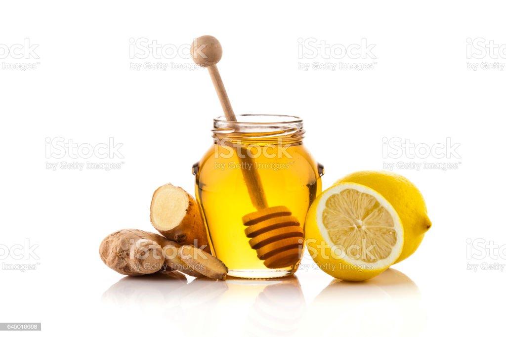 Honey jar , lemons and ginger stock photo