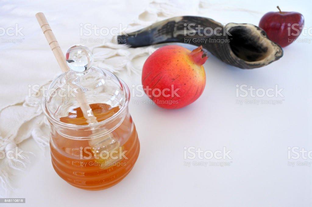 Honey jar, Pomegranate Shofar and red apple stock photo