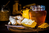 istock Honey jar with honeycomb and bee pollen, ginger and lime 1173786182