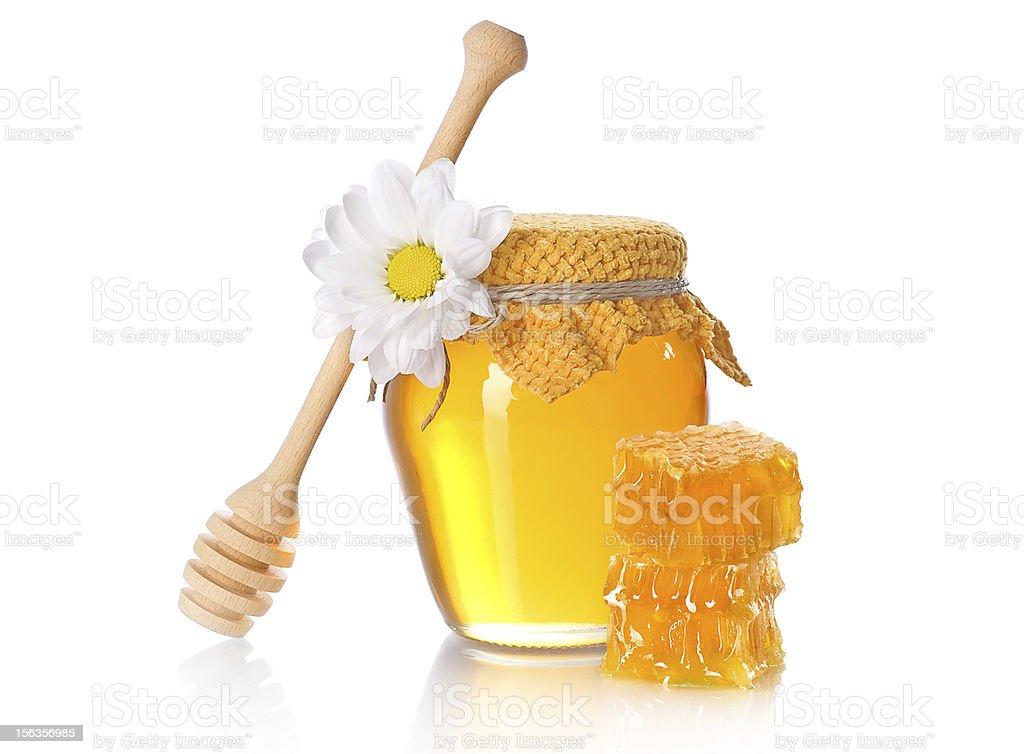 Honey jar with honeycomb slice royalty-free stock photo