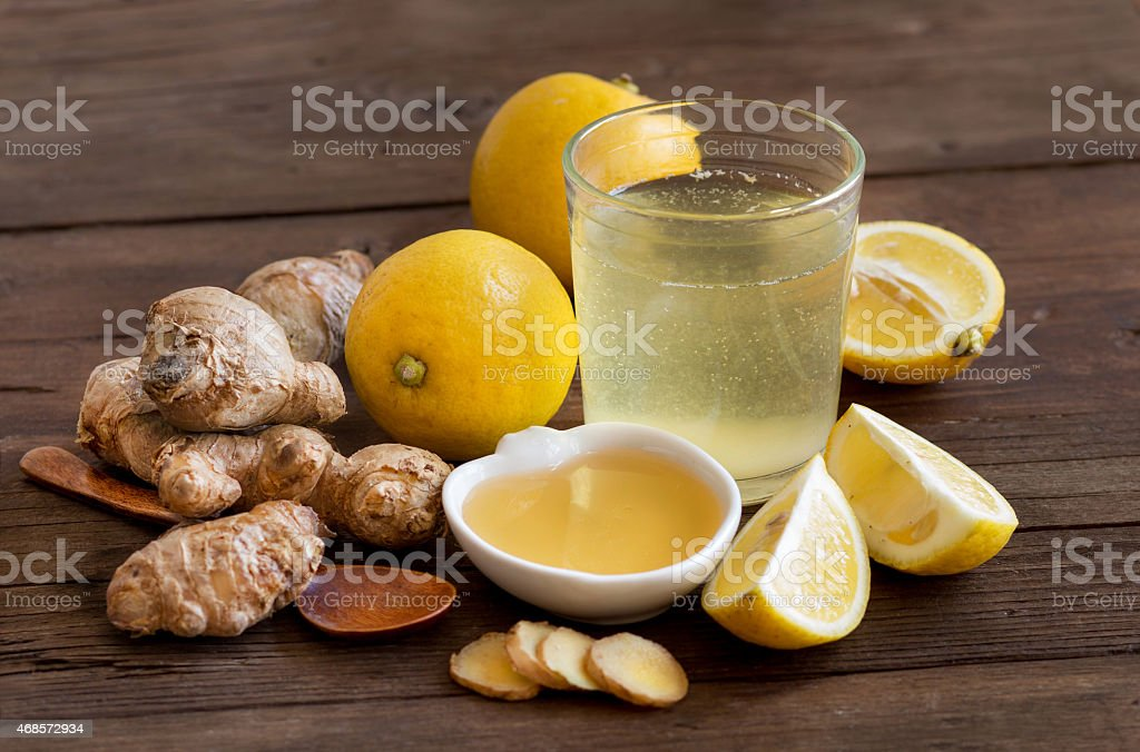 Honey, lemon and ginger tonic set on a wooden table stock photo