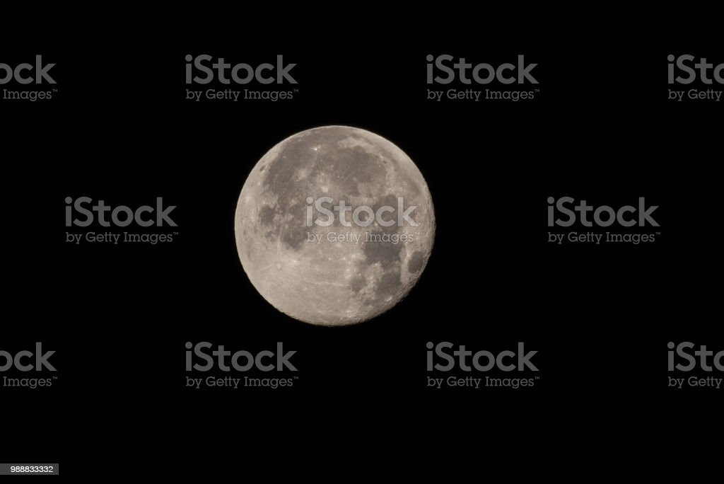 Honey Moon on a clear night glows. stock photo