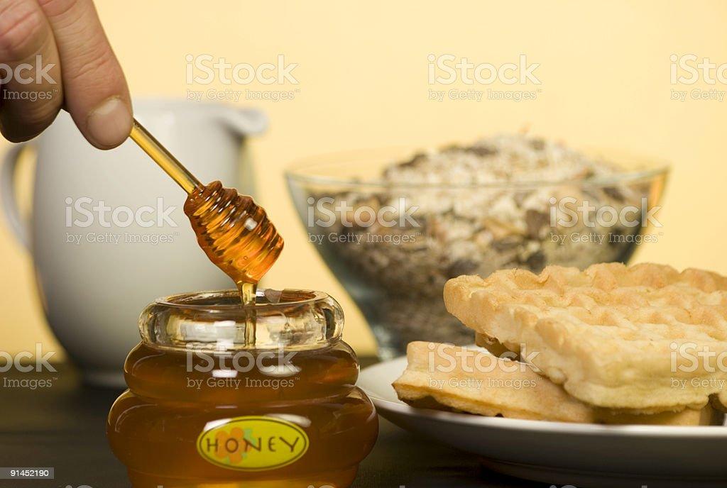 Honey Pot with waffles. royalty-free stock photo