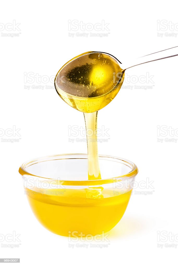 Honey pouring from the spoon royalty-free stock photo