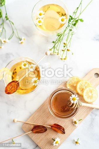 Table set flat lay with honey lemons and, tea honey spoons and chamomile tea
