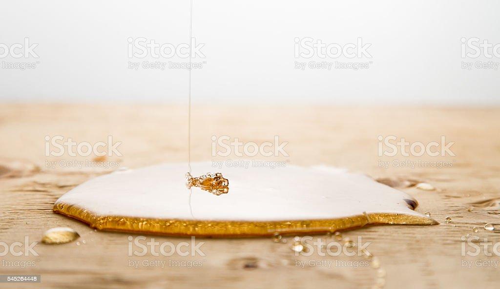 Honey spilled stock photo