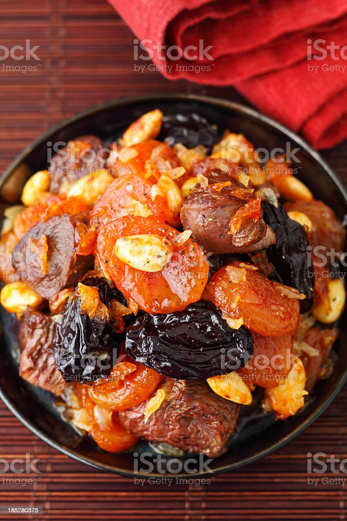 Honey trail mix in a black bowl stock photo