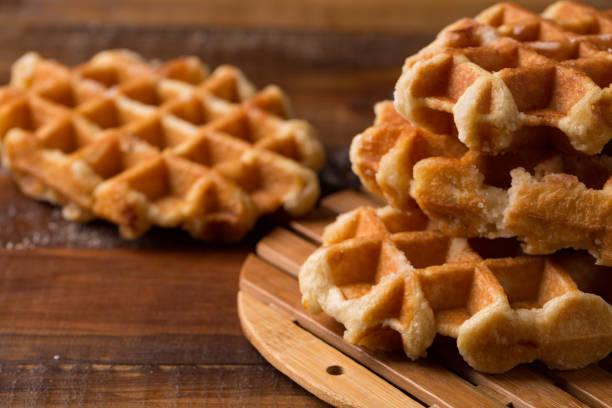Honey Waffle Put On white Plate, honey waffle put on wooden table, delicious honey waffle Honey Waffle Put On white Plate, homemade honey waffle put on wooden table, delicious honey waffle waffle stock pictures, royalty-free photos & images