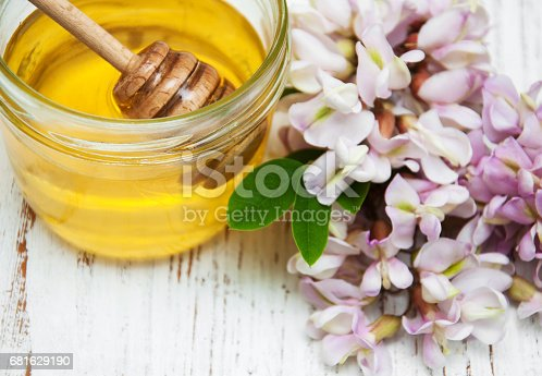 istock honey with acacia blossoms 681629190