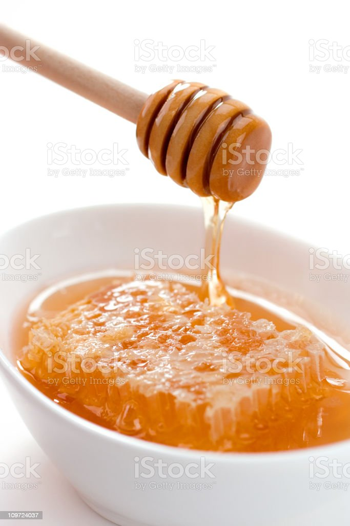 Honey with Honeycomb in Bowl stock photo