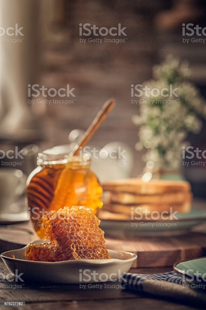 Honey with Honeycombs in a Jar royalty-free stock photo