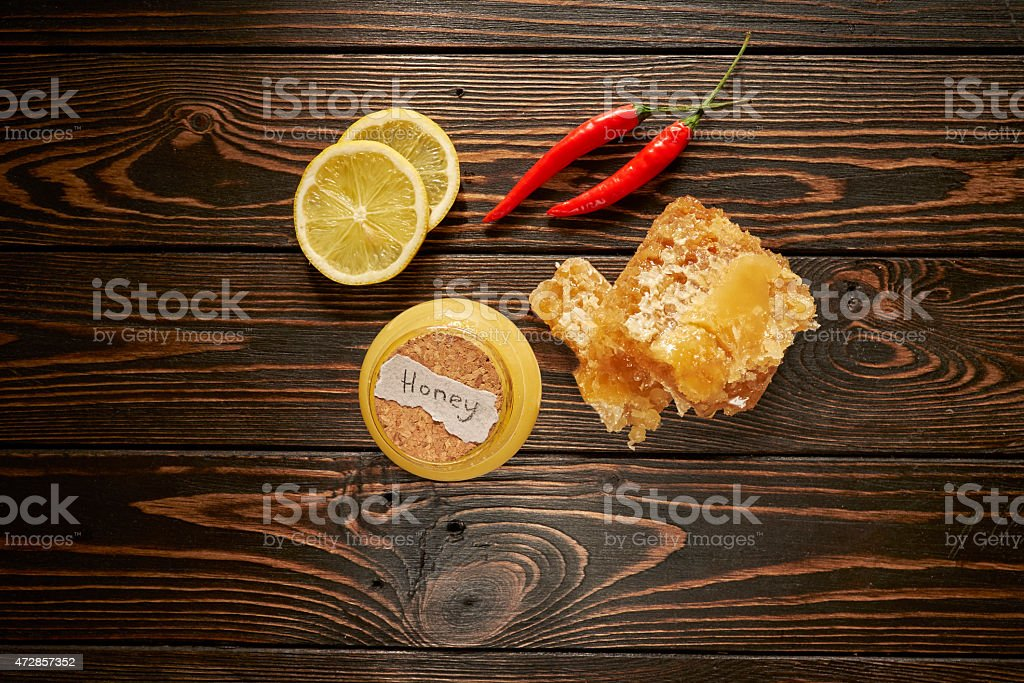 Honey with lemon and spices stock photo
