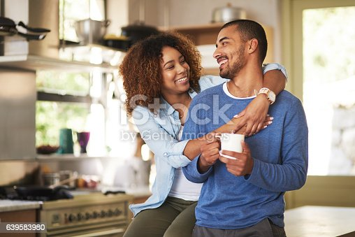 Shot of a happy young couple feeling relaxed in the at home