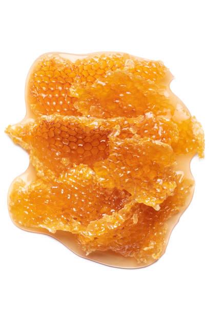 honeycomb on white - honeycomb imagens e fotografias de stock