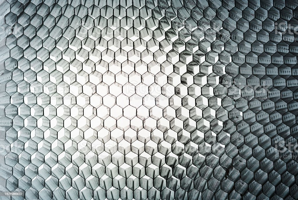 Honeycomb panel close-up, abstract texture with light Studio close-up of a honey-comb metal panel, light-weight, sturdy and flexible. Colour-Toned. AdobeRGB Abstract Stock Photo