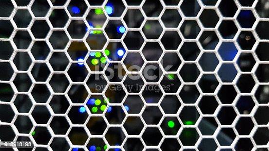 istock Honeycomb pattern doors inside data server rack 918918198