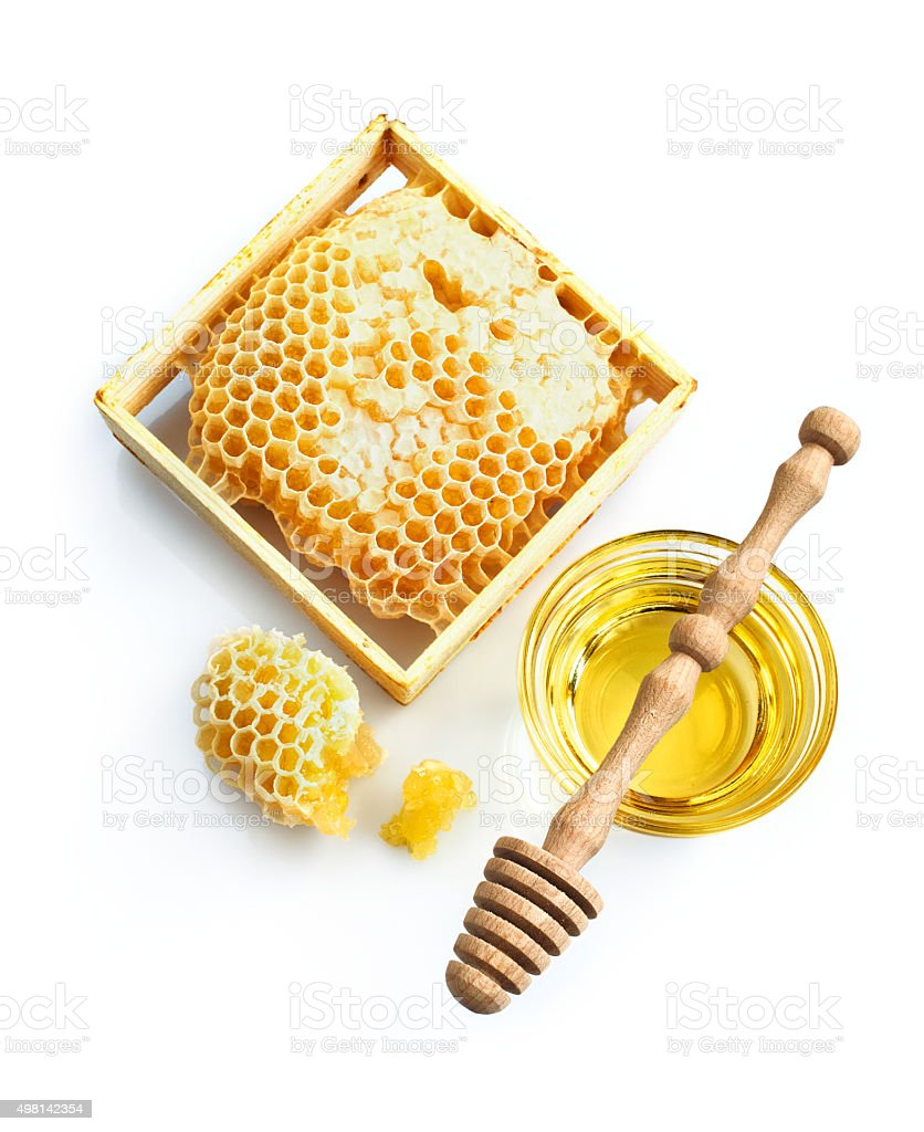 Honeycomb with fresh honey and dipper stok fotoğrafı