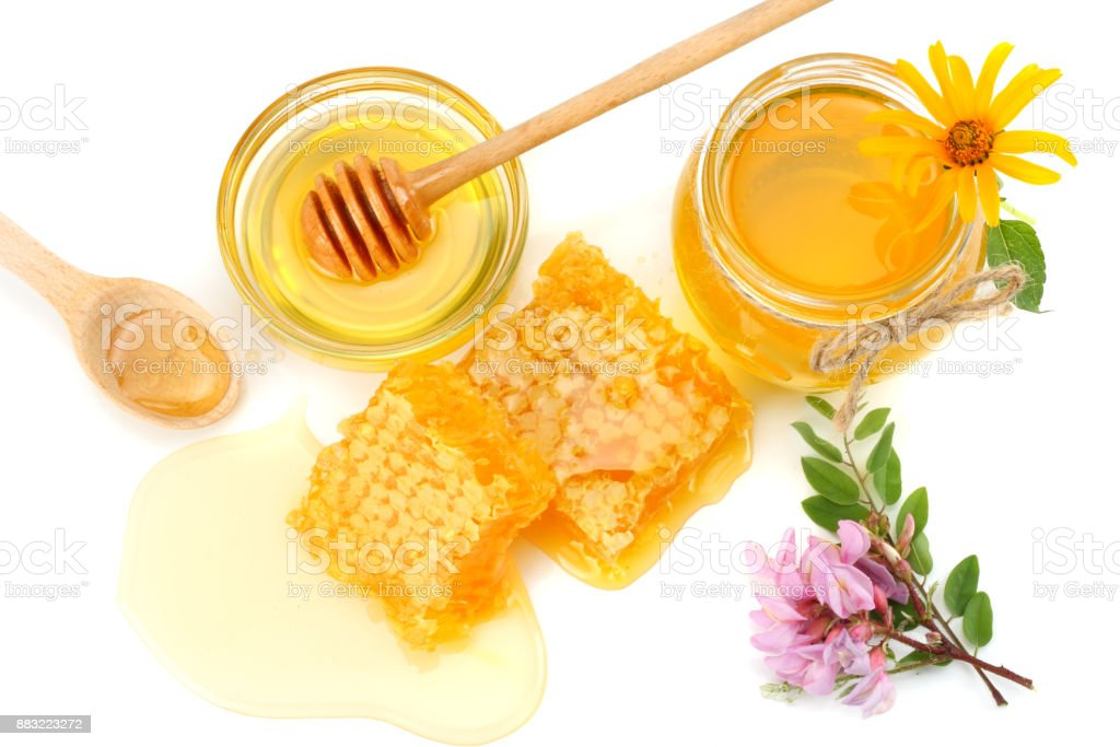 Honeycomb with honey dipper and honey isolated on white background. top view stock photo