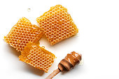 istock Honeycomb with honey spoon isolated on white background. 1184422990
