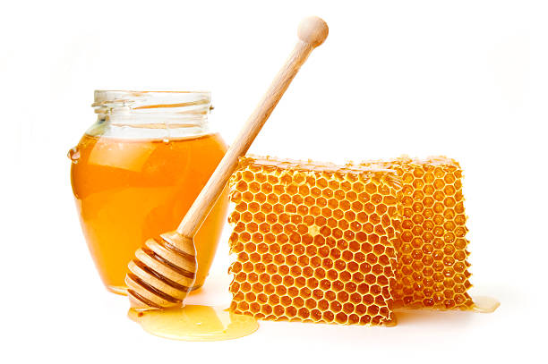 Honeycomb with jar stock photo