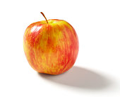 Honeycrisp apple silhouetted on white background with drop shadow.  Professionally shot, silhouetted, color corrected, exported 16 bit and retouched for maximum image quality, larger files include path.
